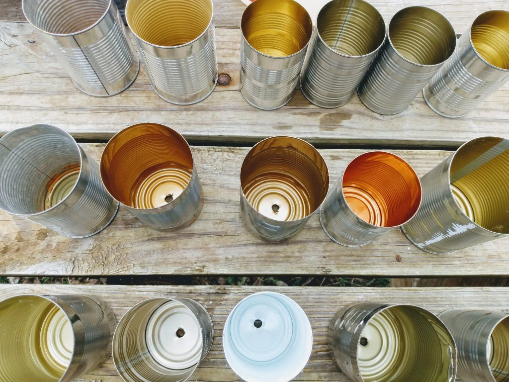 Empty Soup Cans with Drainage Holes Drilled In The Bottom To Be Used As Planters
